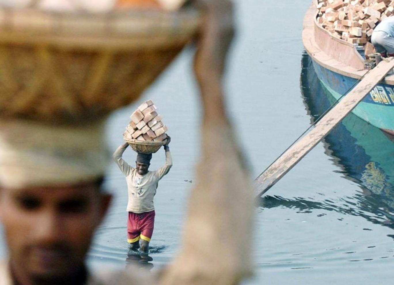 Bangladeshi labourers moving bricks: The country's economy is tipped for strong growth