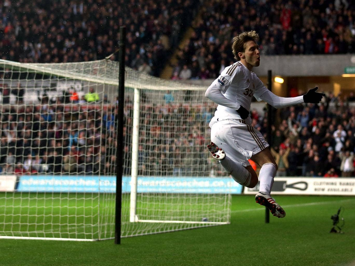 Swansea's Michu celebrates one of his two goals over QPR