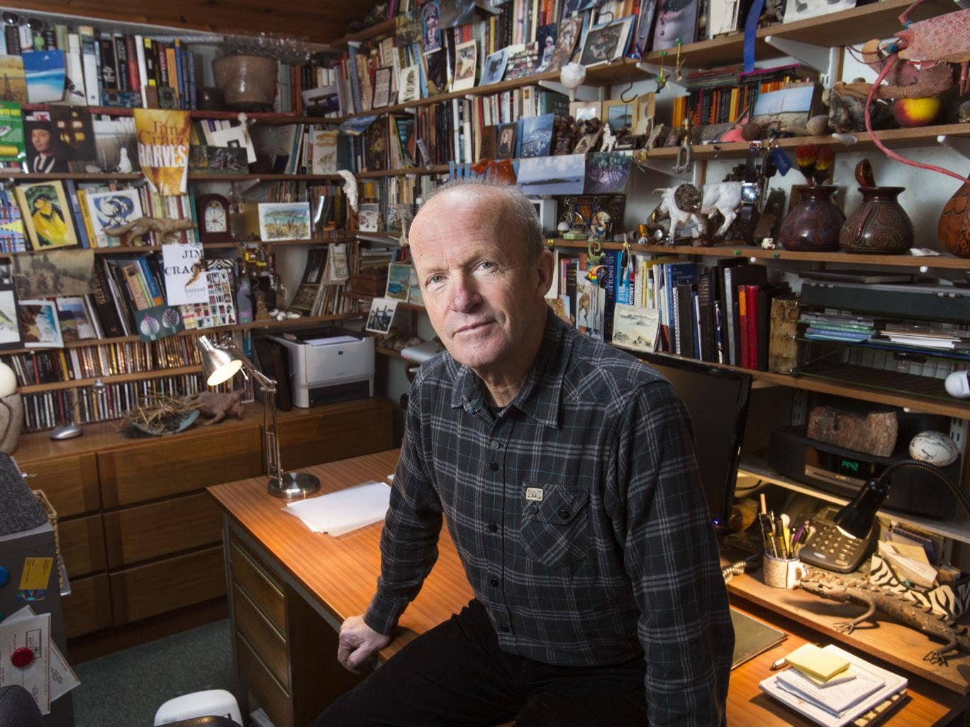 Writer's den: Jim Crace with the geckos, twigs, and fossils in his study