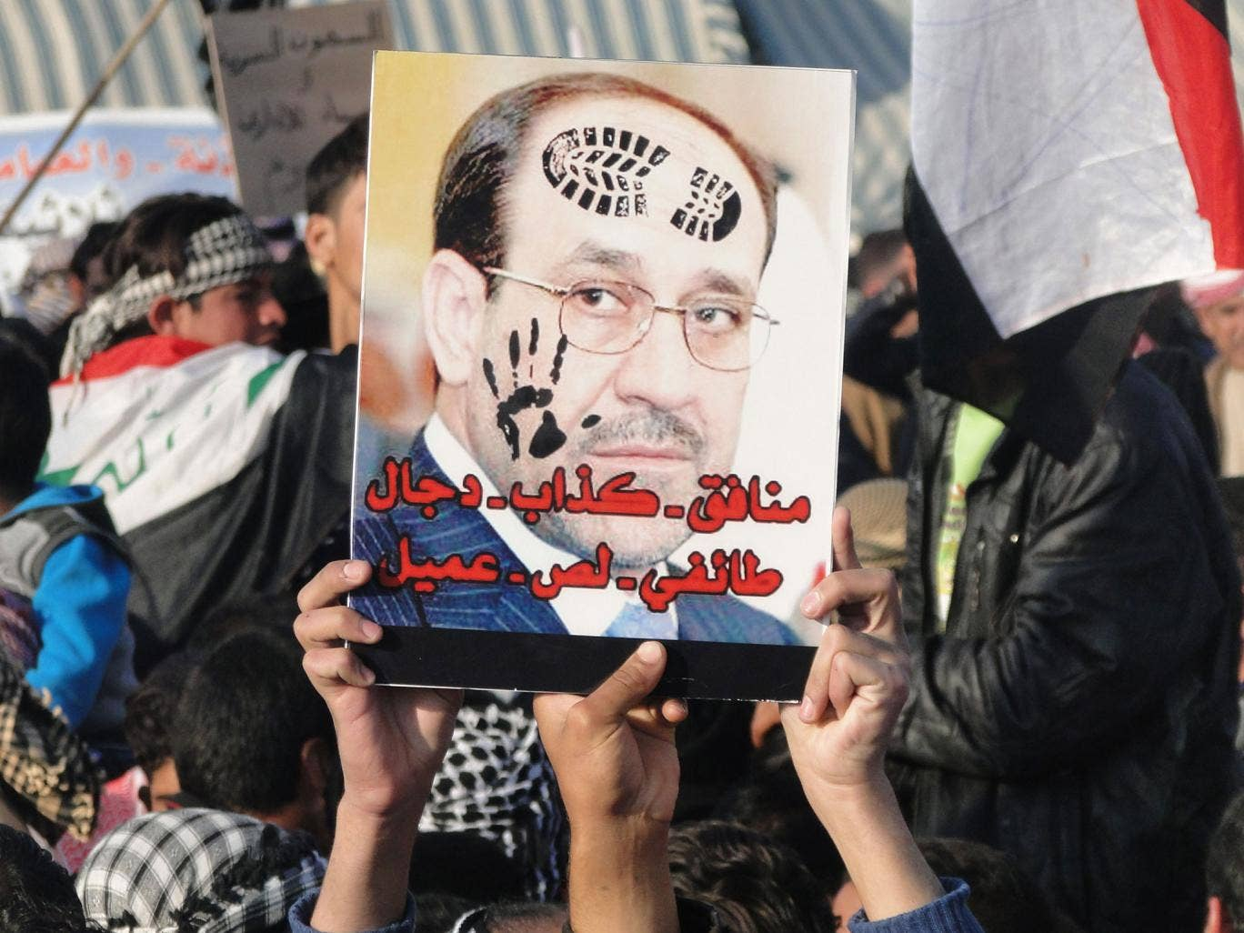 Hate figure: Sunni protesters in Anbar province with a poster of Nouri al-Maliki