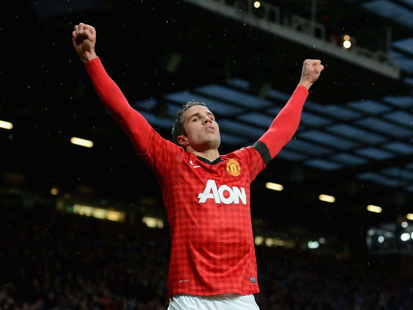 Robin van Persie celebrates scoring his goal
