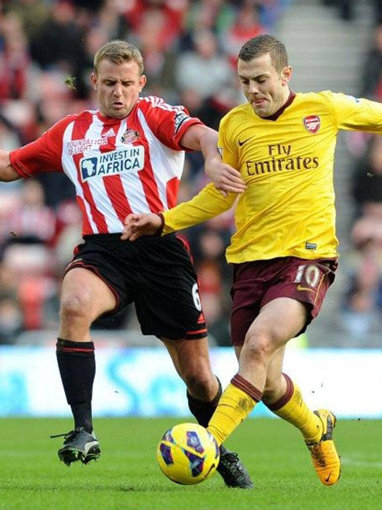 Jack Wilshere holds off the advances of Lee Cattermole on Saturday