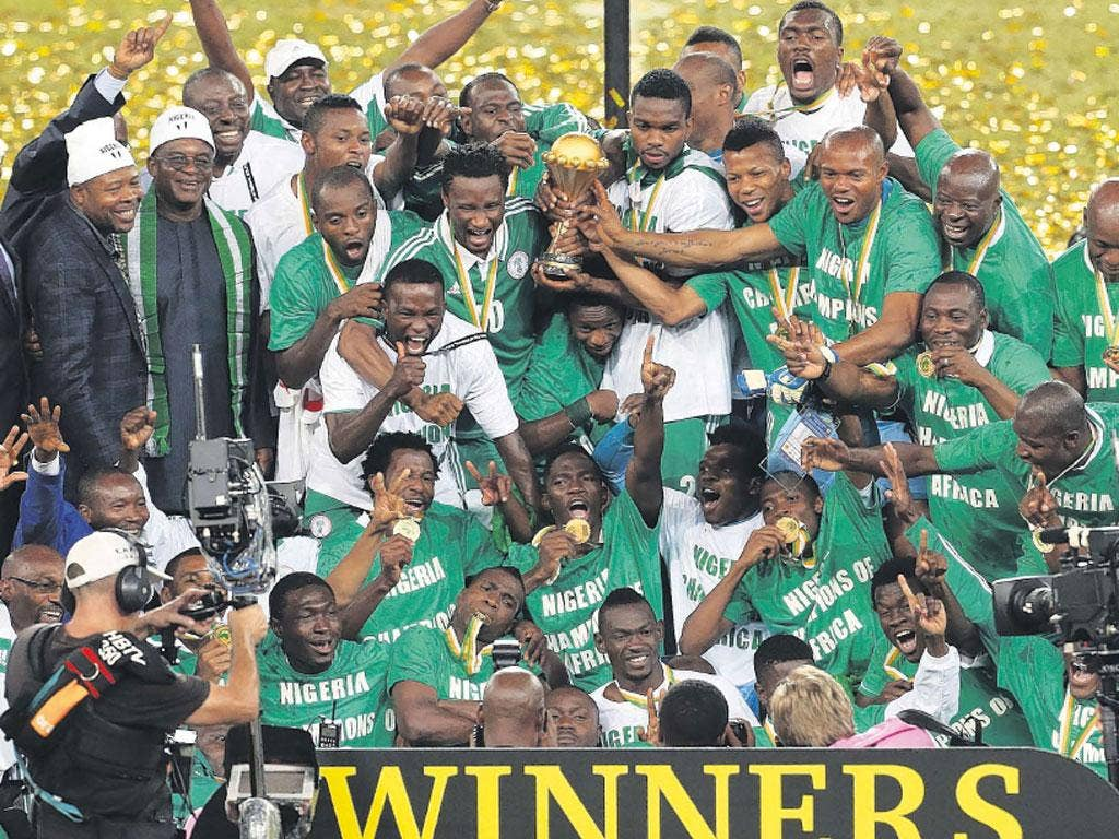 Nigeria's players celebrate after winning the Cup