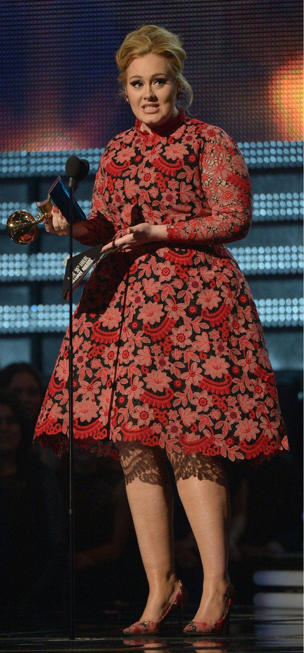 Adele receives the Grammy for best pop solo performance