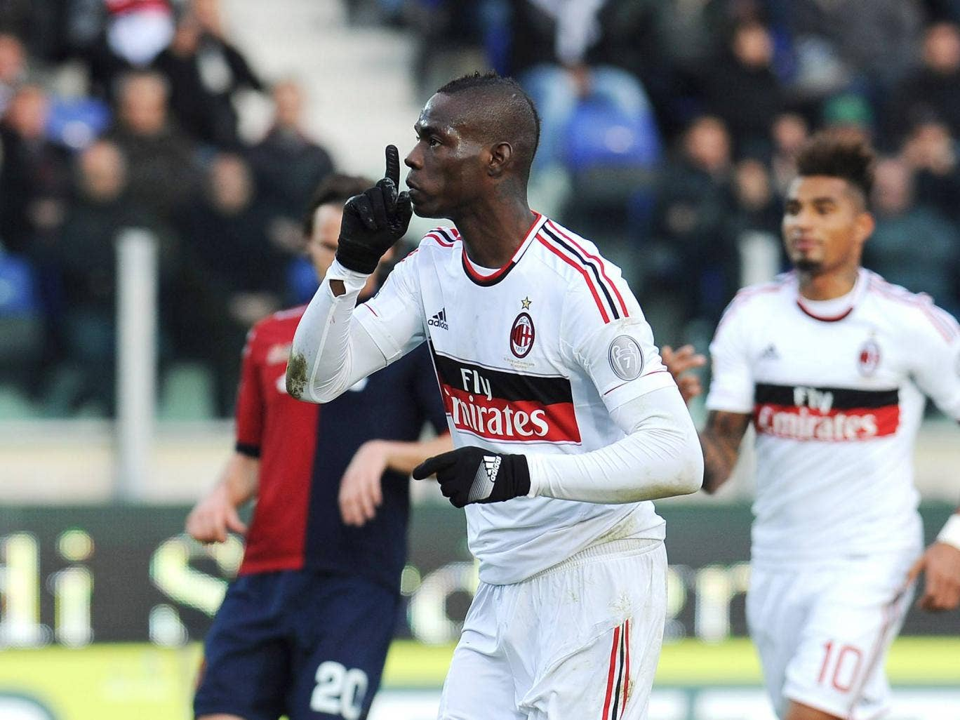 Mario Balotelli of AC Milan celebrates his goal scored from the penalty spot during the Serie A match between Cagliari Calcio and AC Milan at Stadio Is Arenas