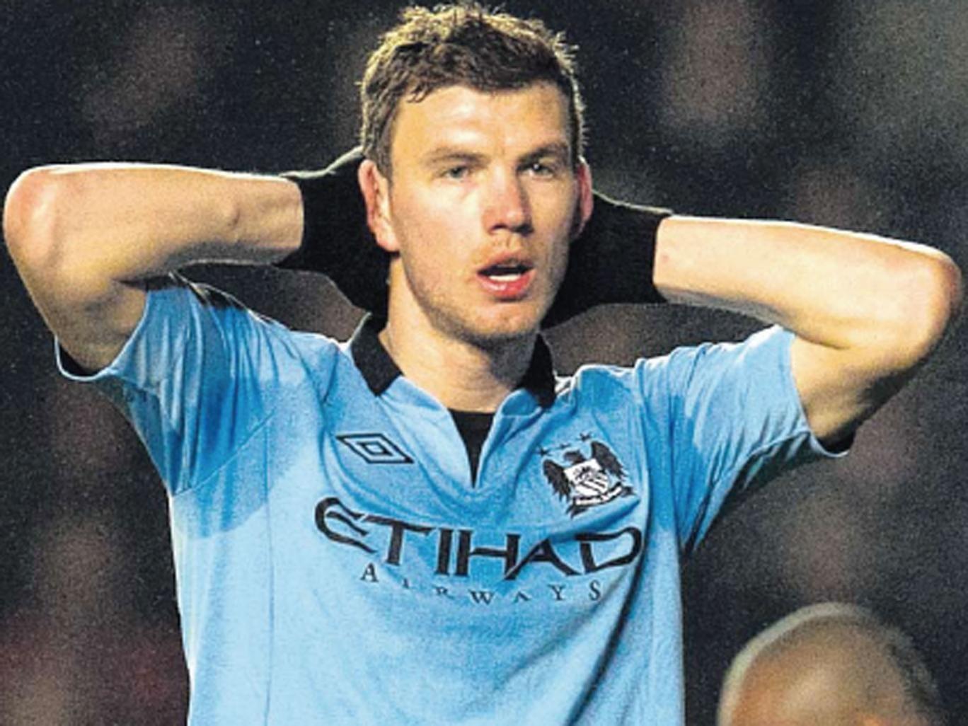 Manchester City striker Edin Dzeko could lose his starting place
