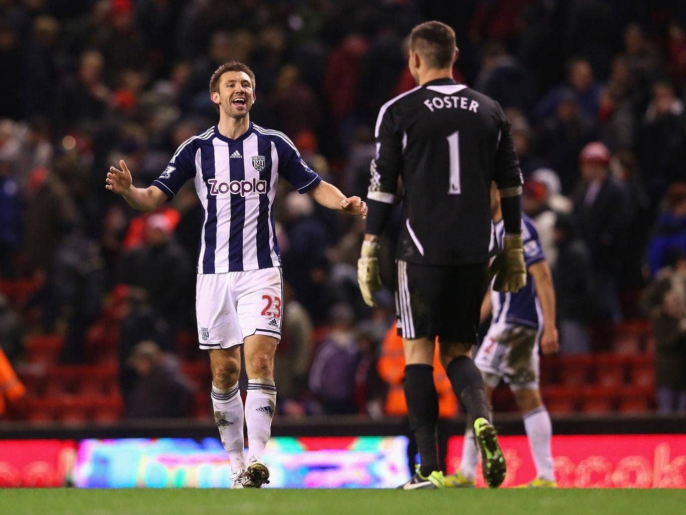 Gareth McAuley and Ben Foster of West Brom celebrate victory over Liverpool at Anfield