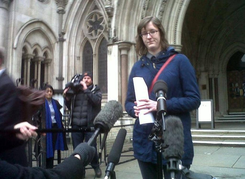 Cait Reilly speaks to the media after she won a Court of Appeal ruling that a Government flagship back-to-work scheme requiring her to work for free at a Poundland discount store was unlawful