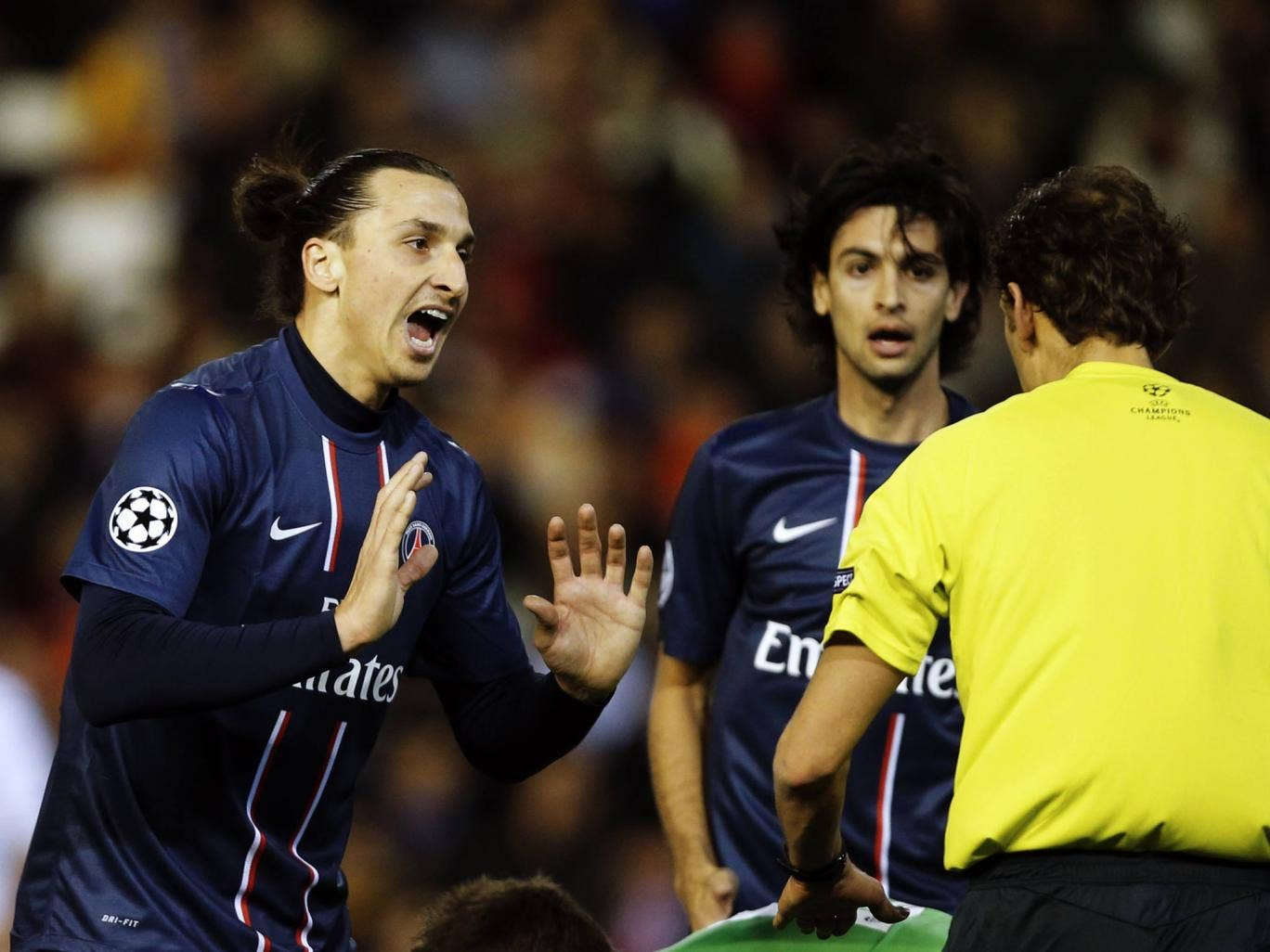 PSG striker Zlatan Ibrahimovic protests his innocence after being sent off against Valencia
