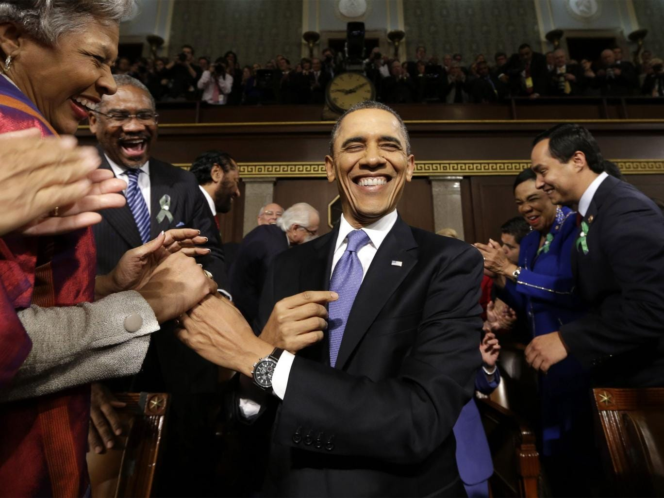 President Barack Obama is greeted before his State of the Union address