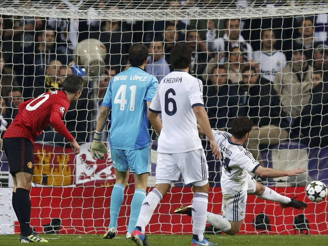 Robin Van Persie can only watch in vain as Xabi Alonso clears his mis-hit effort off the line last night