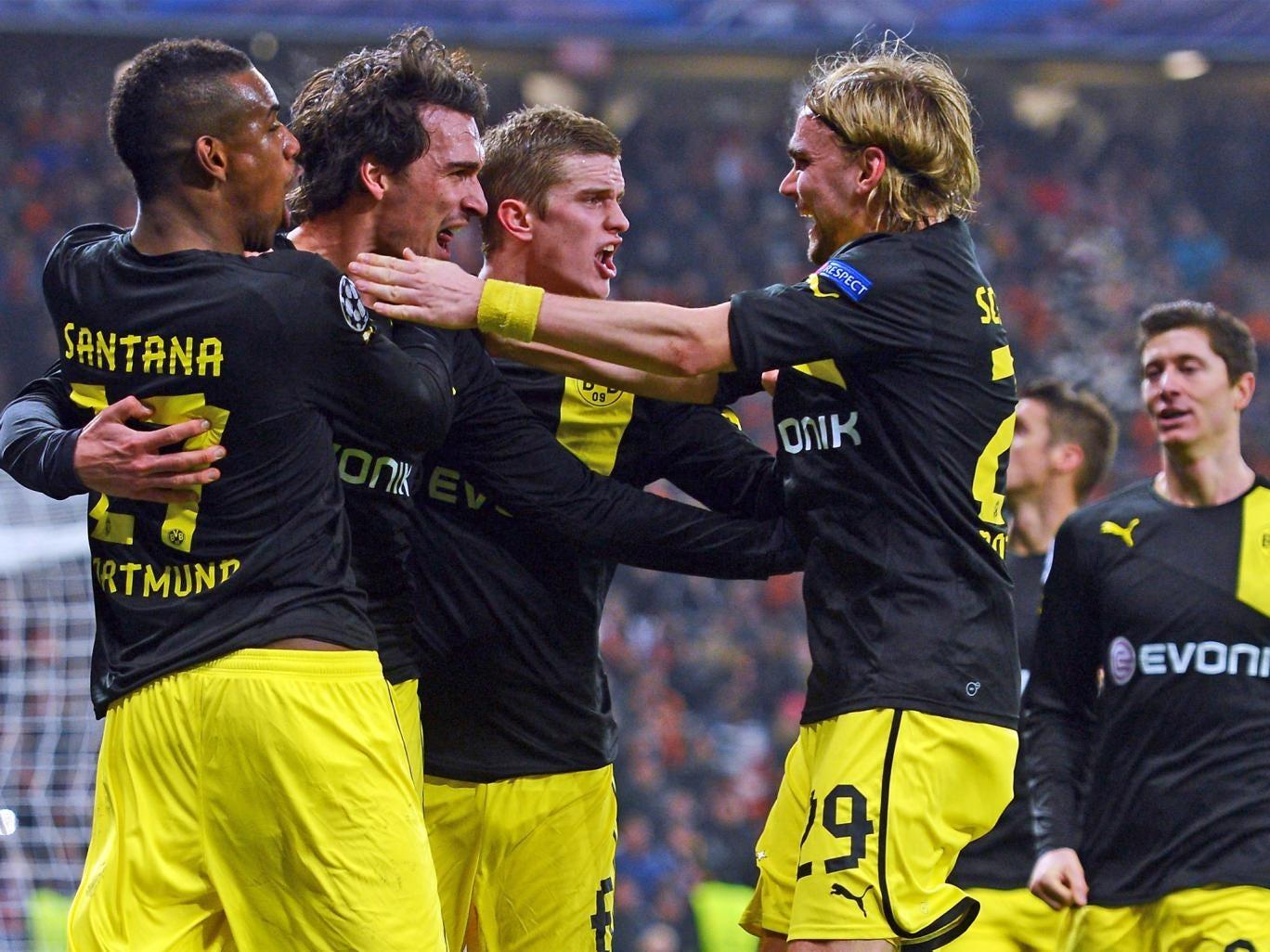 Dortmund's Mats Hummels celebrates with his teammates