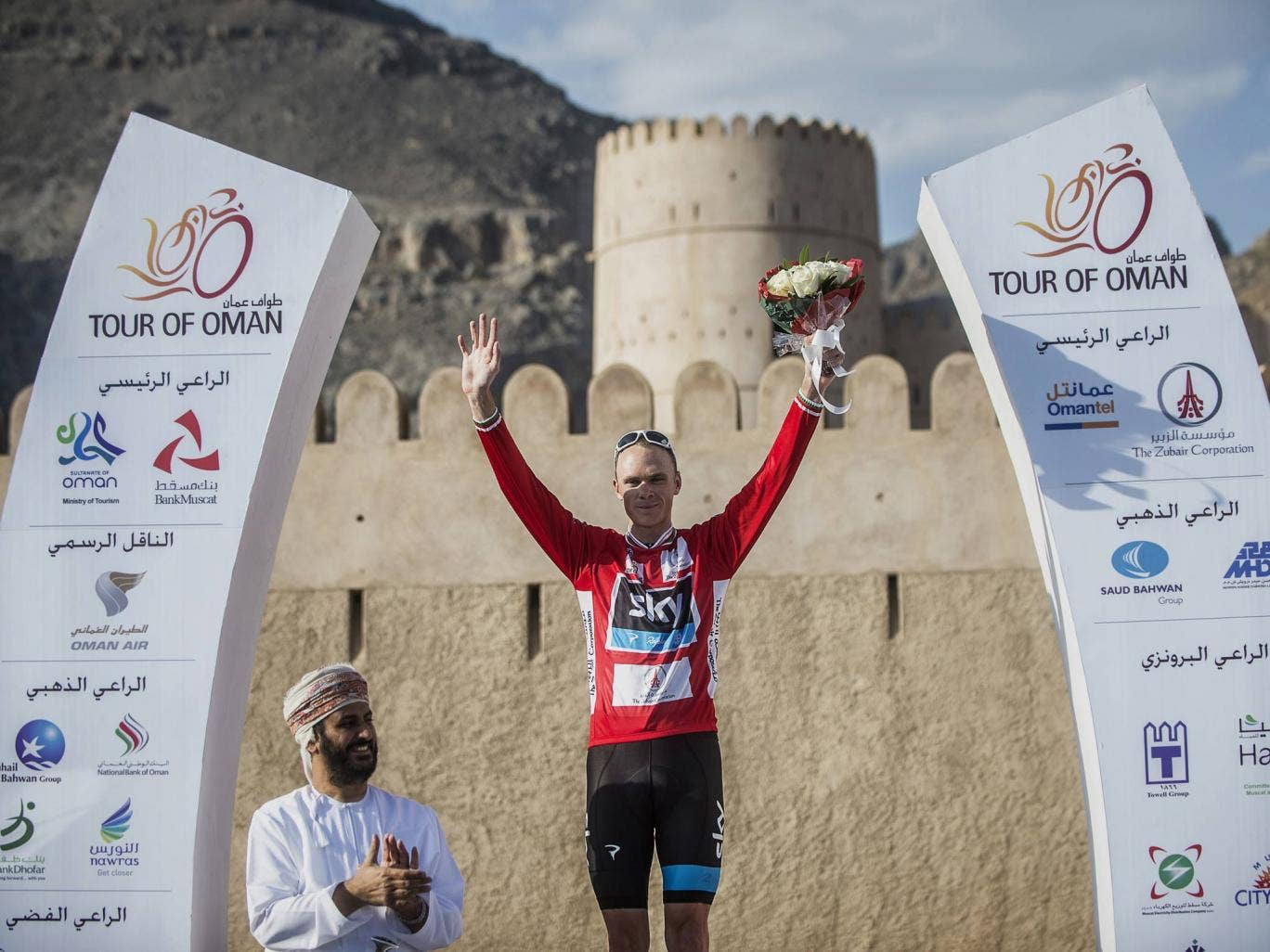 Chris Froome with the Tour of Oman leader's red jersey