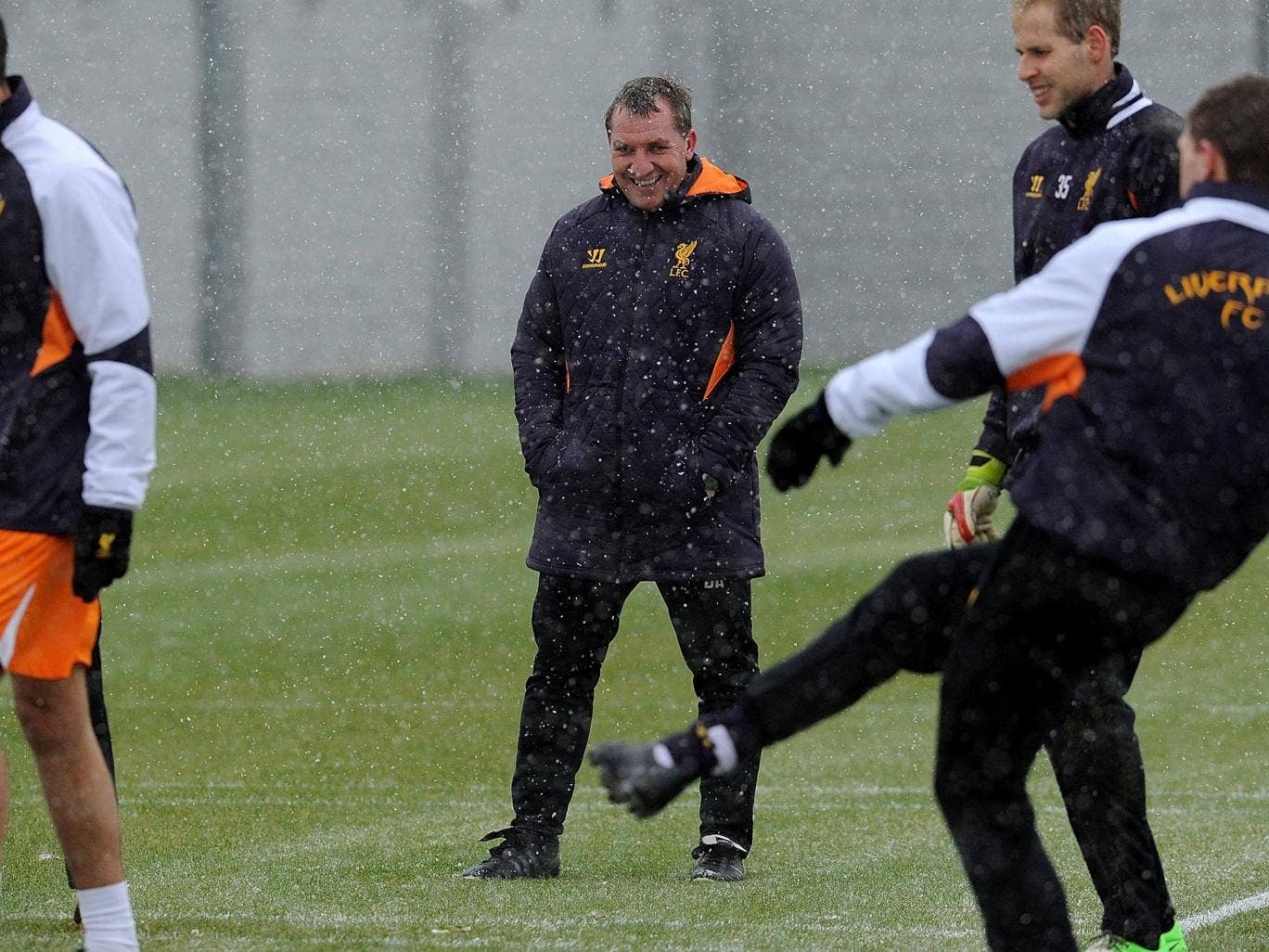 Brendan Rodgers watches over Liverpool training