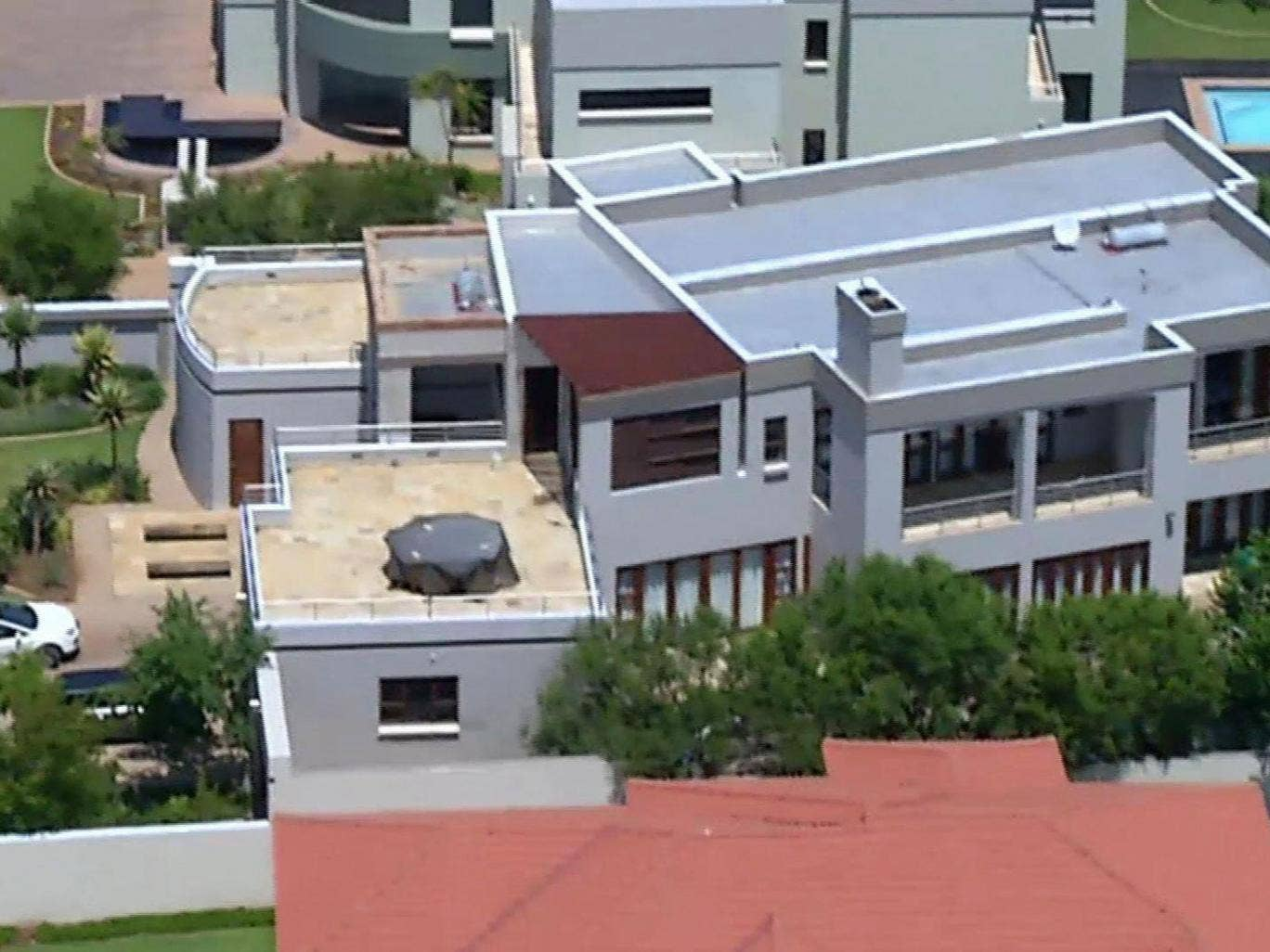 Scene of the tragedy: the house where Oscar Pistorius lived with Reeva Steenkamp in Silver Woods is heavily protected