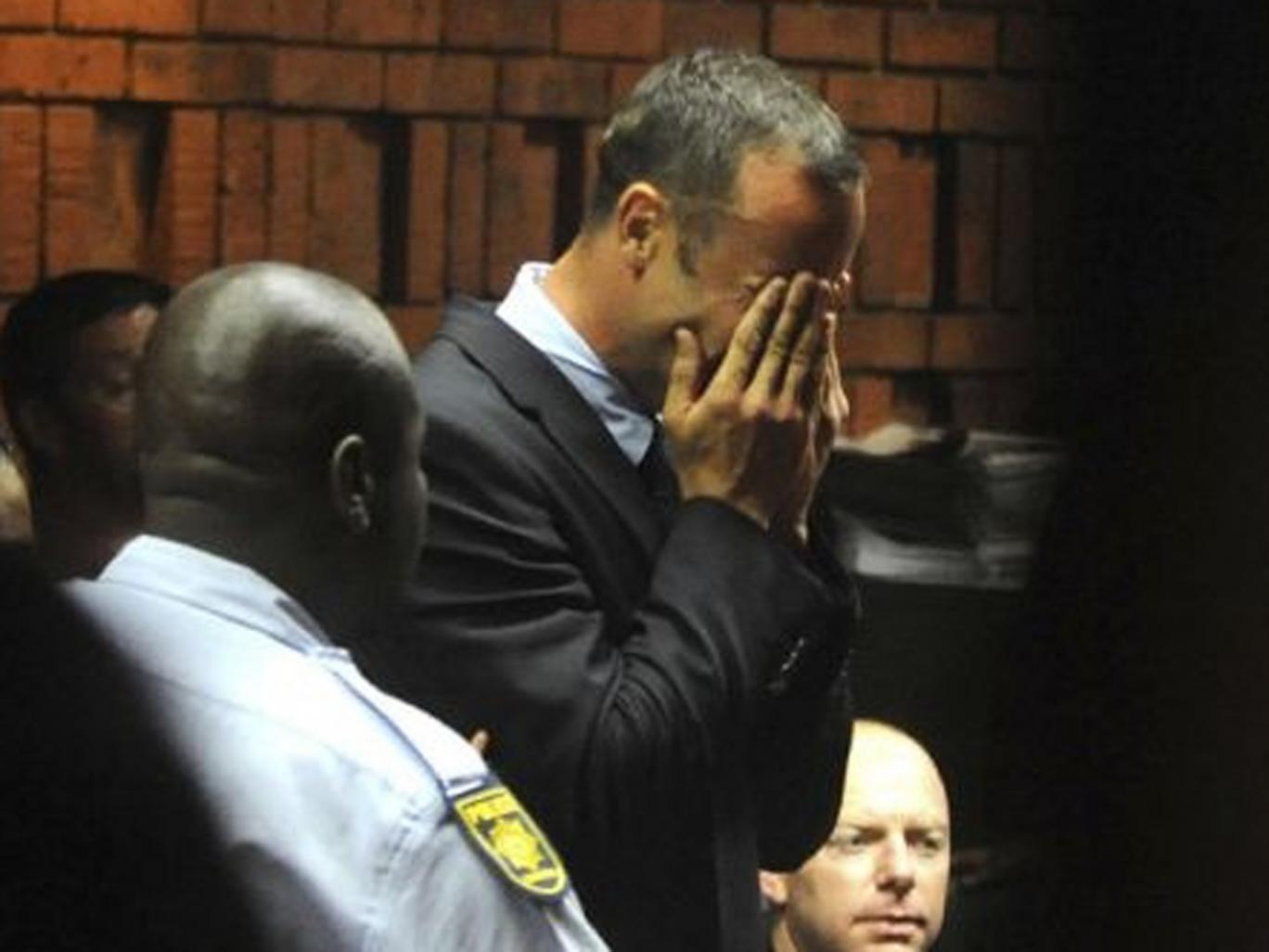Athlete Oscar Pistorius weeps in court in Pretoria at his bail hearing in the murder case of his girlfriend Reeva Steenkamp