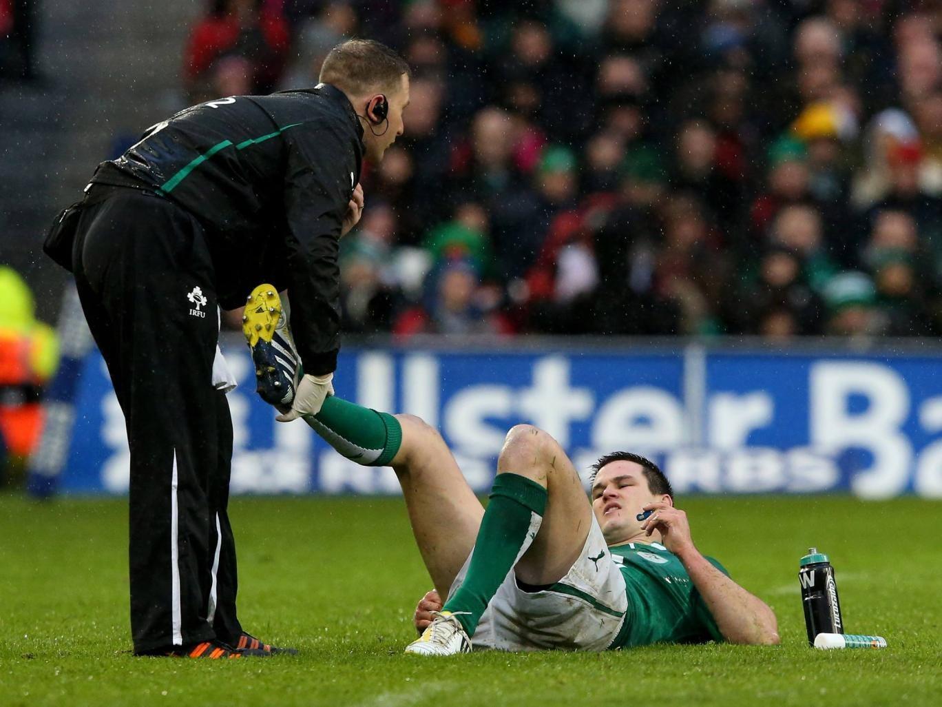 Ireland's Jonathan Sexton picks up an injury against England