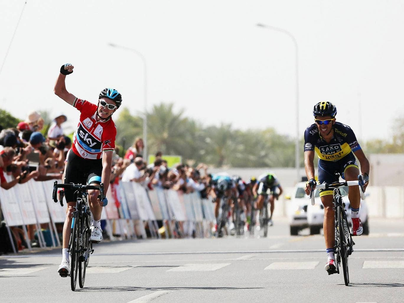 Chris Froome beats Alberto Contador to the line in on the Tour of Oman