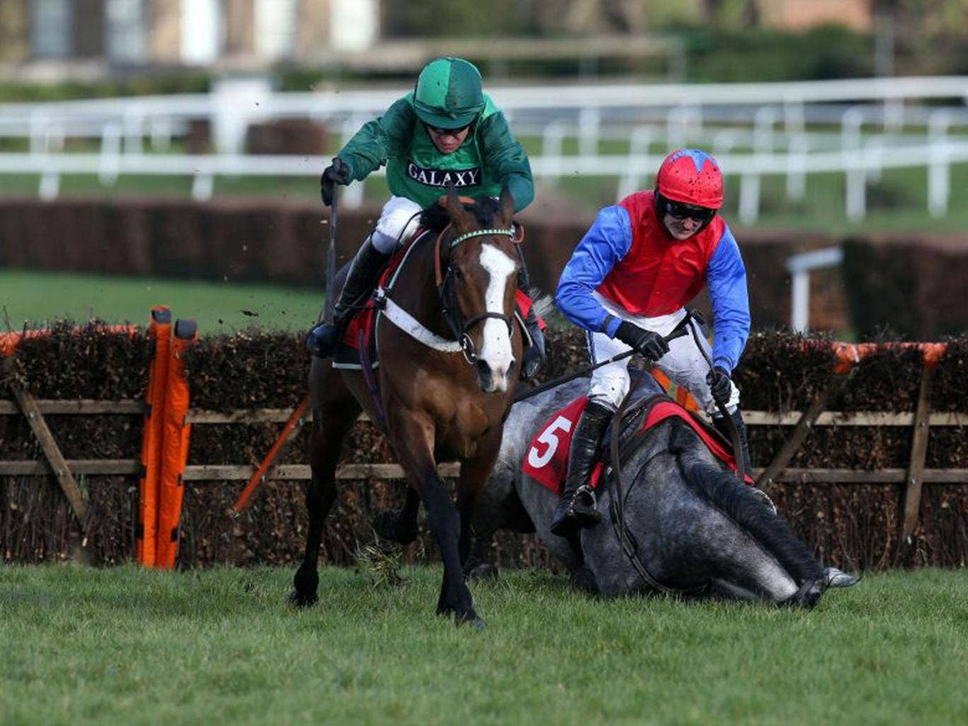 Utopies des Bordes (left) on her way to victory at Sandown yesterday