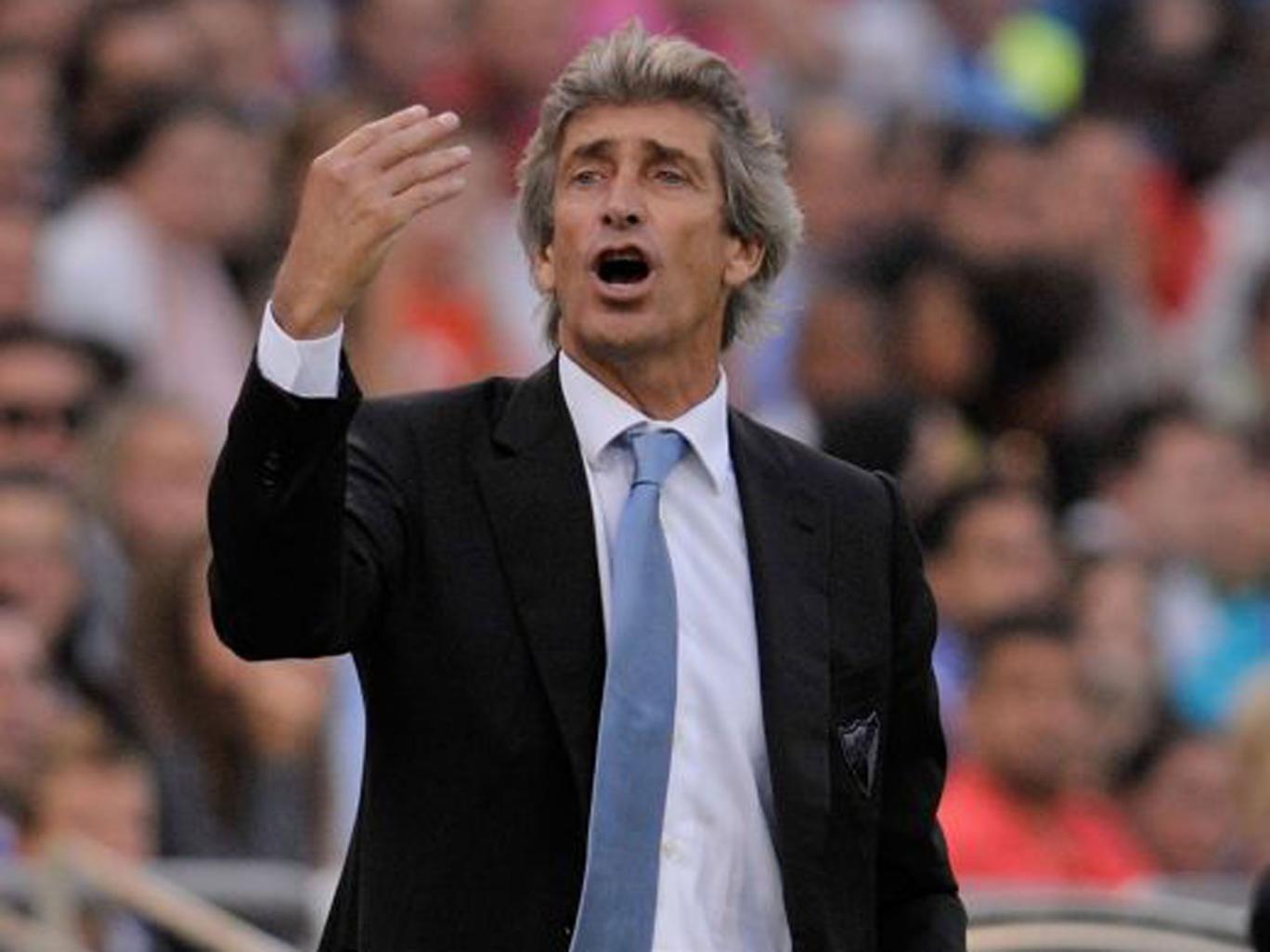"Malaga coach Manuel Pellegrini ""would love to coach in England"