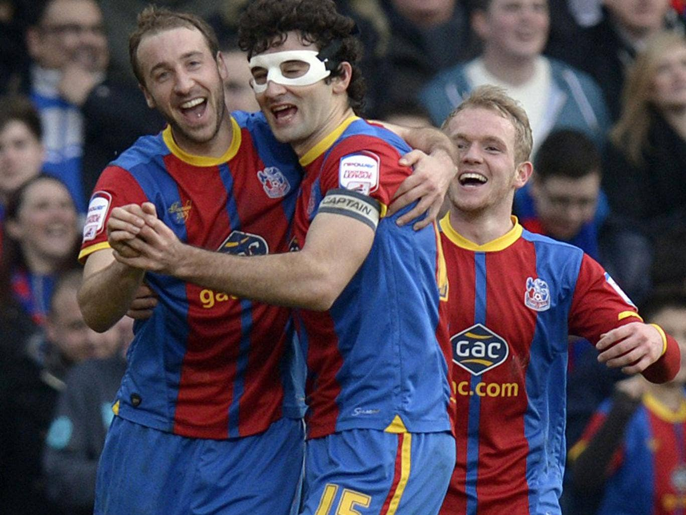 Masked ball: Glenn Murray and Mile Jedinak celebrate Palace's goal-feast