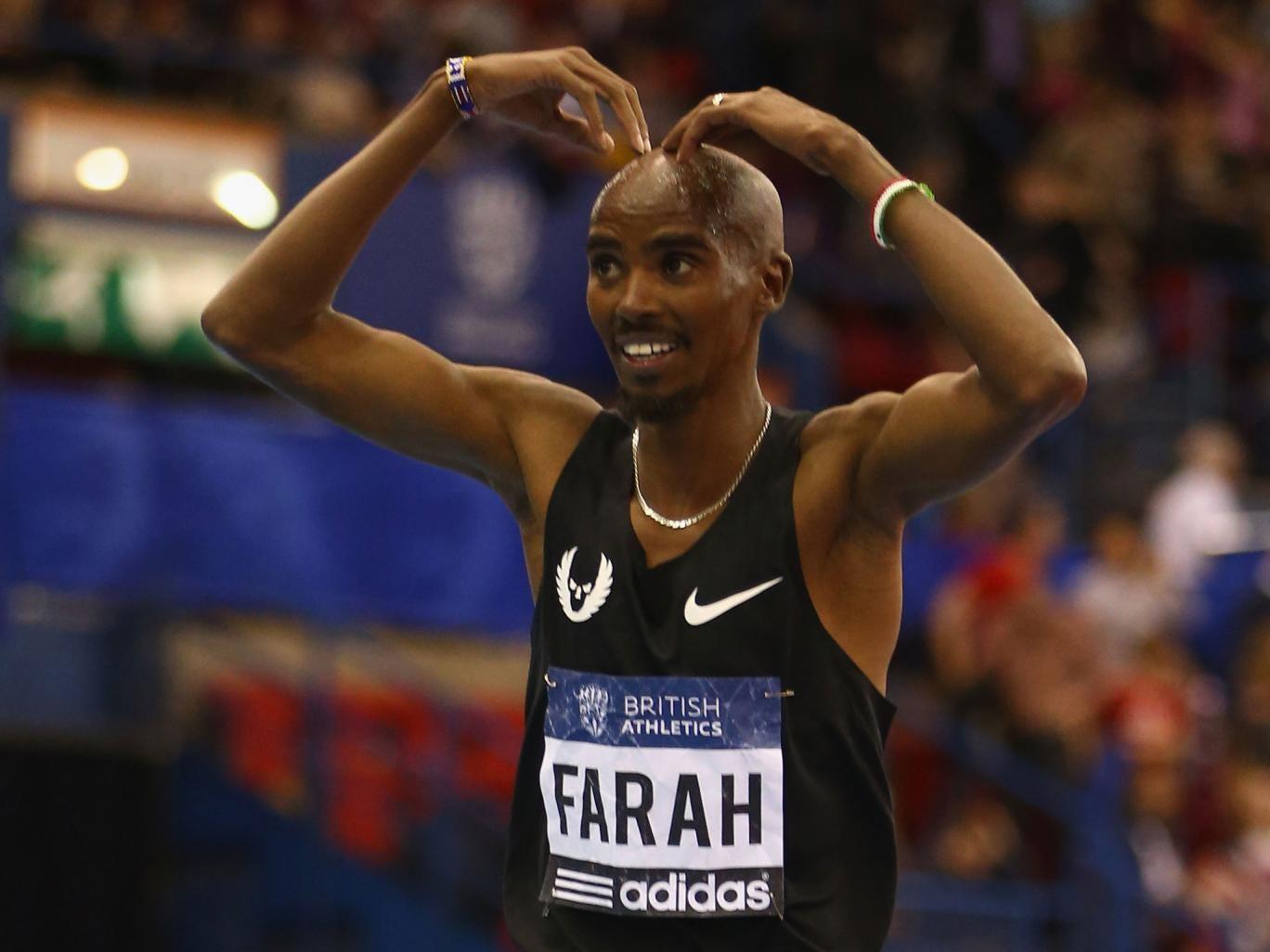 Mo Farah celebrates his 3,000m win