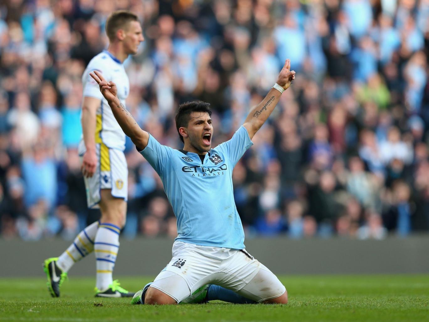 <b>Man City 4-0 Leeds United</b><br/>Sergio Aguero of Manchester City celebrates scoring his team's fourth goal