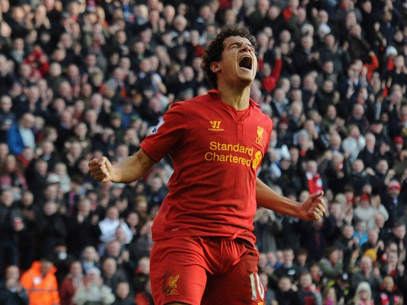 Philippe Coutinho of Liverpool celebrates his goal during the Barclays Premier League match between Liverpool and Swansea City