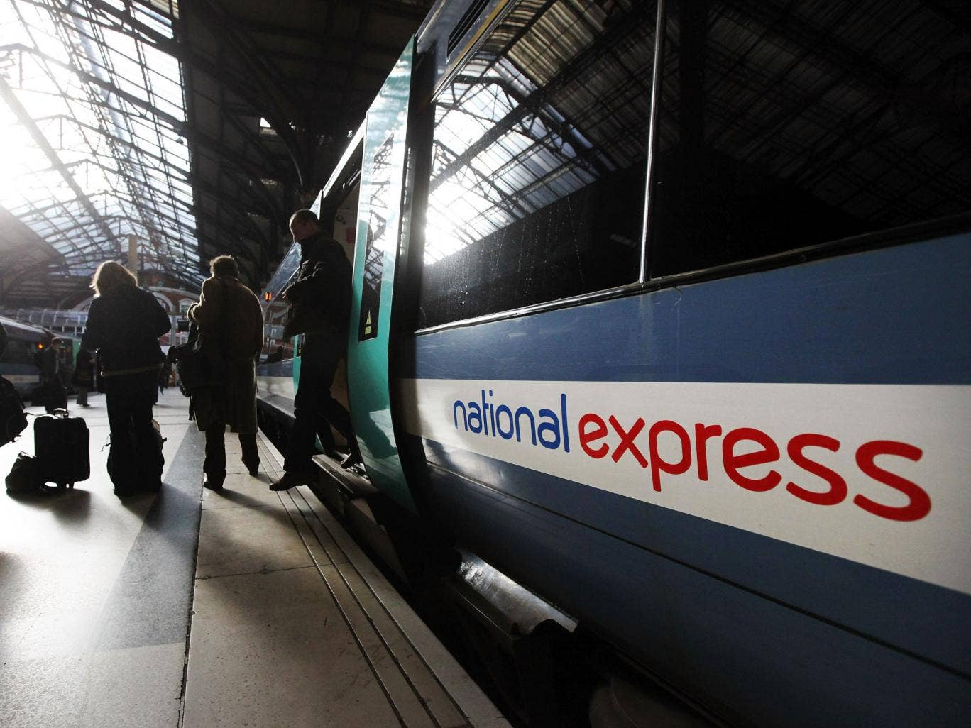 Members of the public disembark a National Express train
