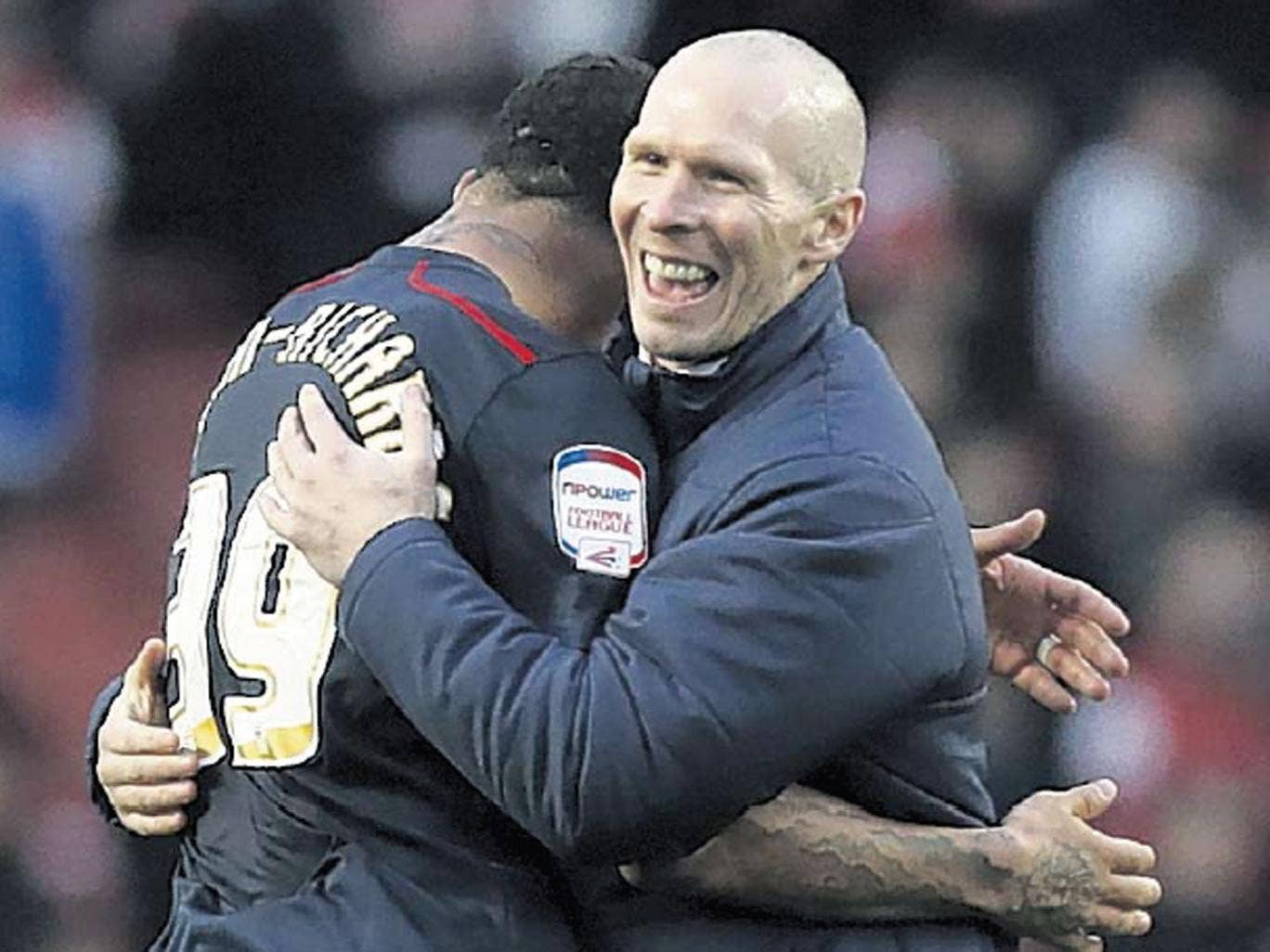 The Blackburn Rovers manager, Michael Appleton, celebrates their shock victory with goalscorer Colin Kazim-Richards