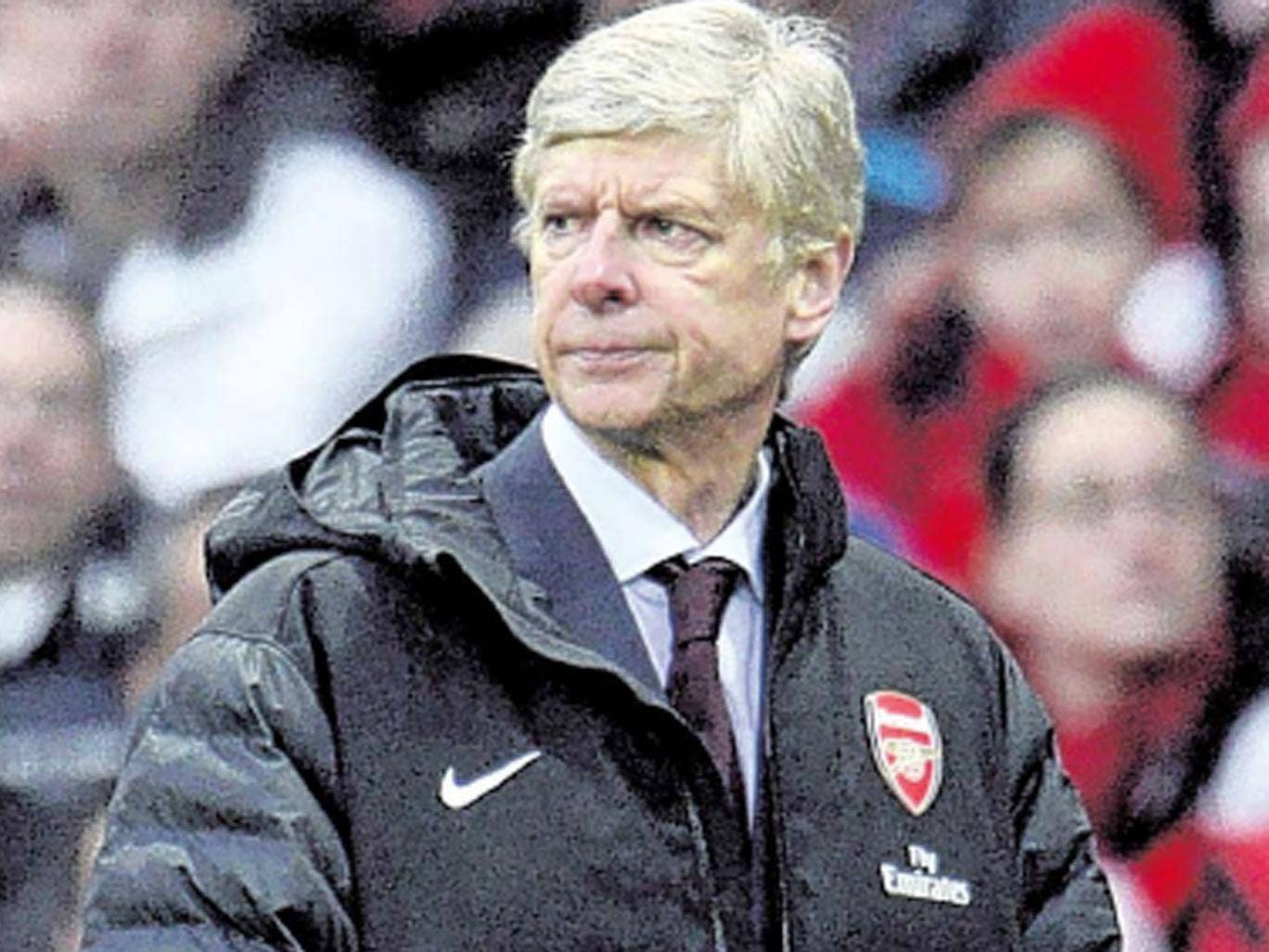 Arsène Wenger watches Arsenal's FA Cup defeat to Blackburn