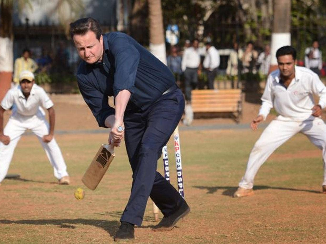 Prime Minister David Cameron plays cricket with Indian boys at the Oval Maidan, a communal cricket pitch in the centre of Mumbai, India