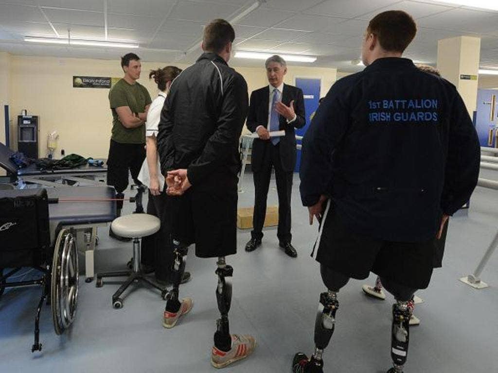 Philip Hammond (second right) during a visit to the Defence Medical Rehabilitation Centre, Headley Court