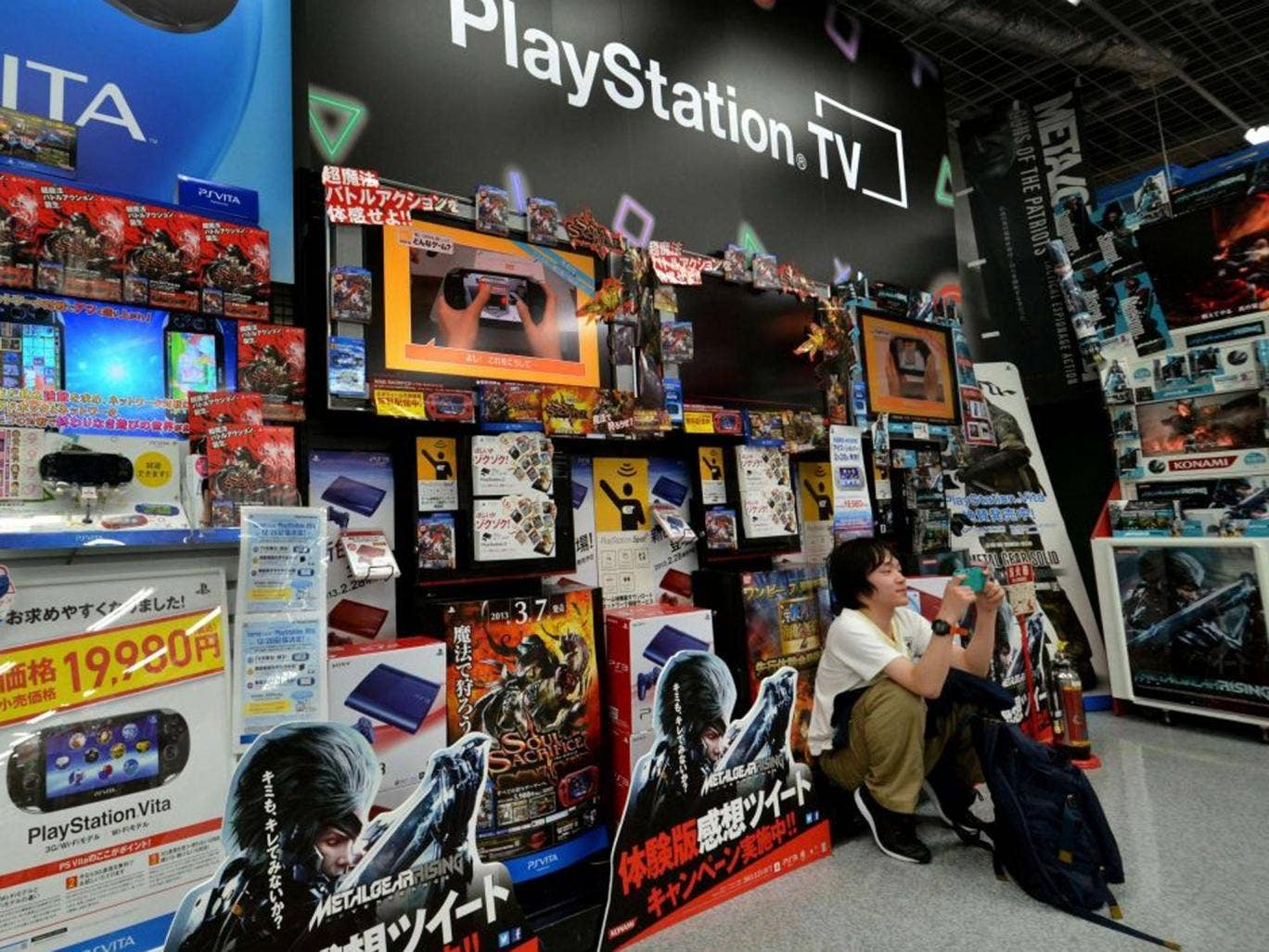 A Japanese video game fan in a Tokyo electrics shop as Sony prepares to reveal its vision of the future of home entertainment by providing a glimpse of a new-generation PlayStation console that streams games, films, music and more