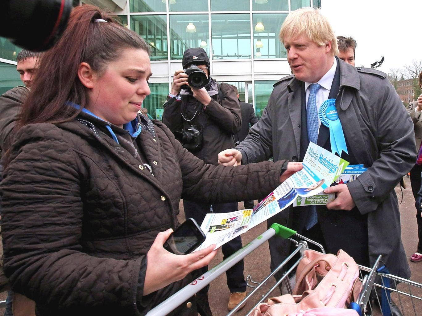 Boris Johnson speaks to a shopper in Eastleigh in support of Conservative candidate Maria Hutchings