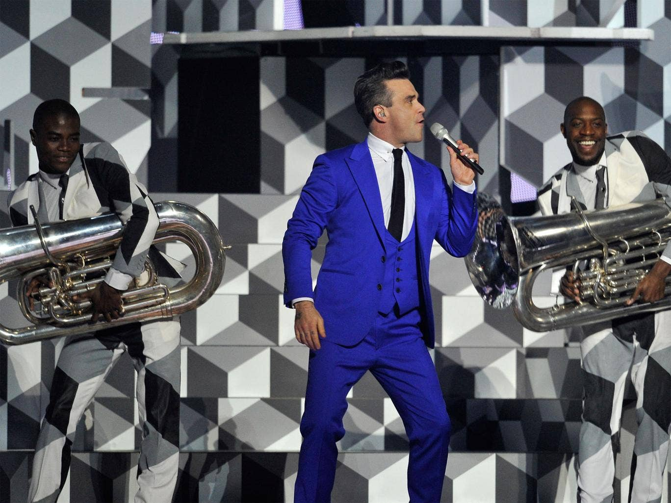 Robbie Williams performs on stage during the Brit Awards