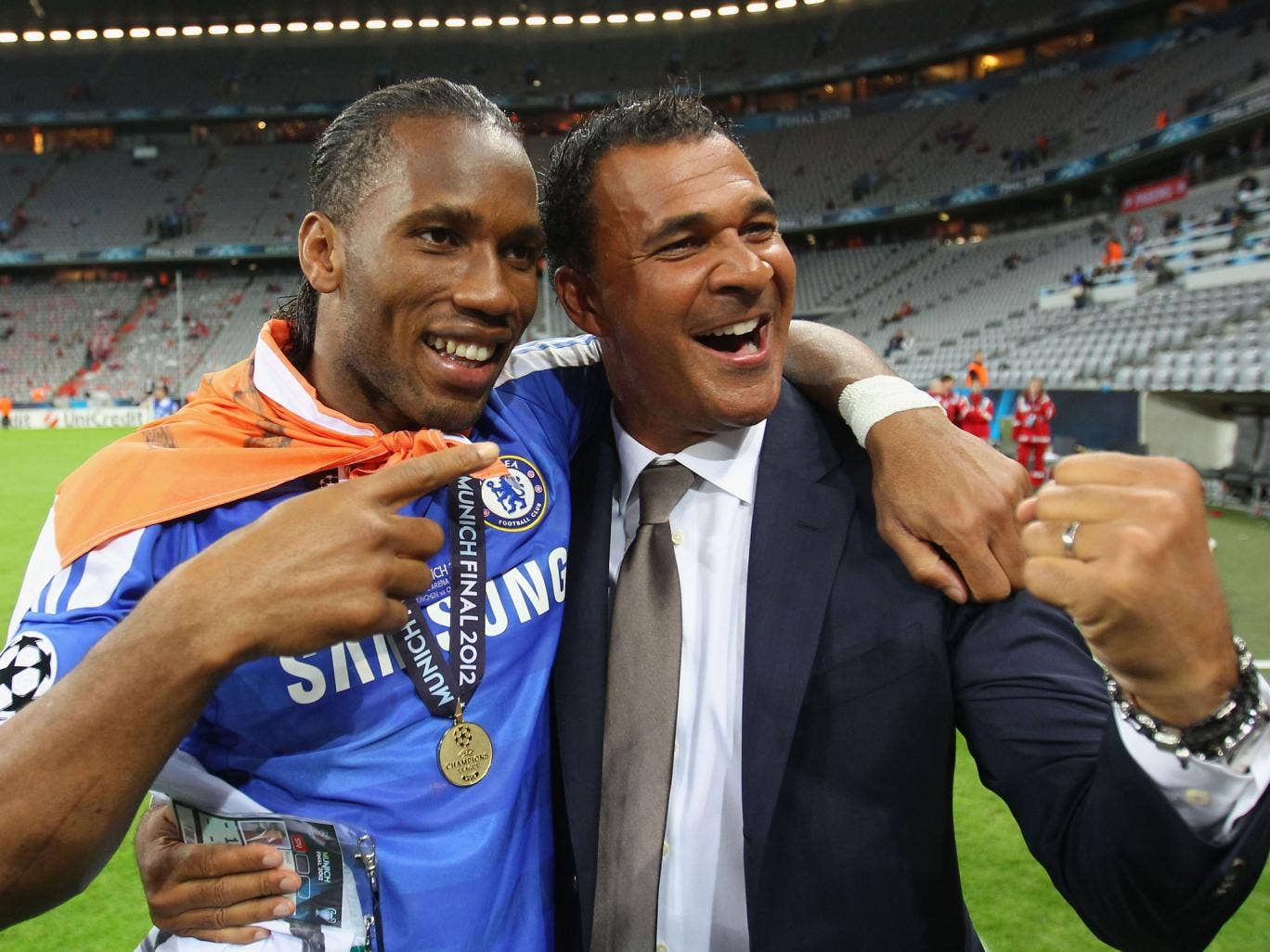 Didier Drogba of Chelsea and former Chelsea manager Ruud Gullit celebrate after their victory in the UEFA Champions League Final