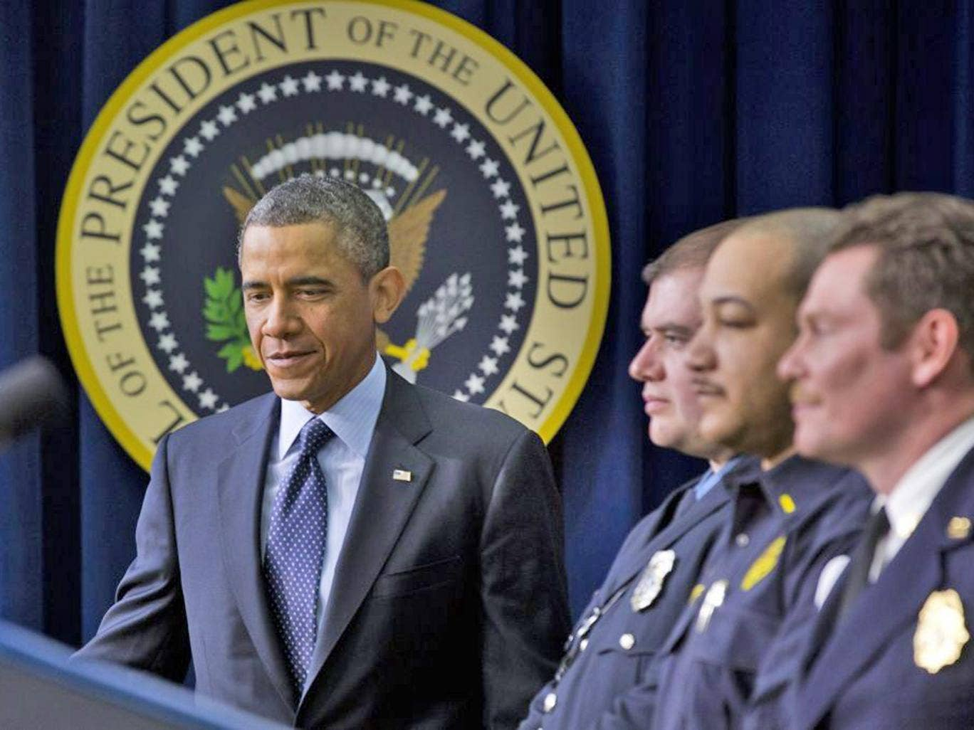 Barack Obama with emergency responders urges Congressional action to stop spending cuts