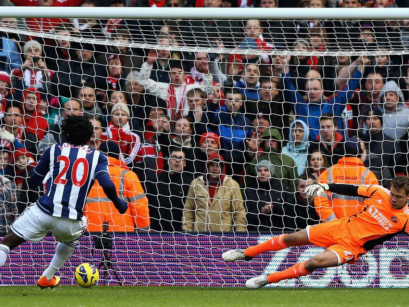 Romelu Lukaku slots home a penalty from West Brom