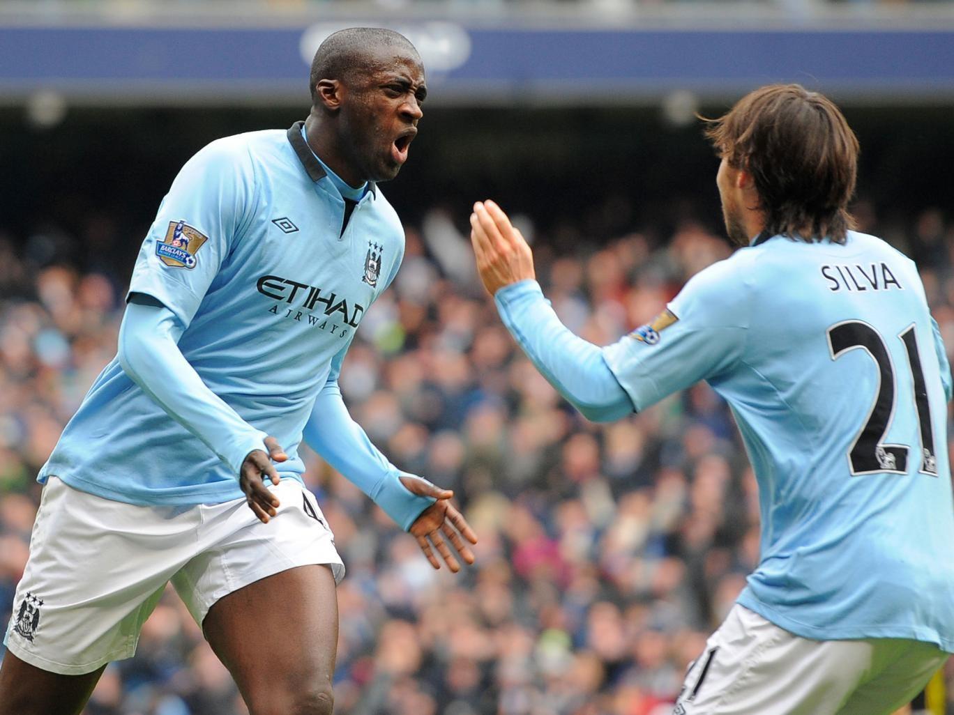 Yaya Toure celebrates his goal with David Silva