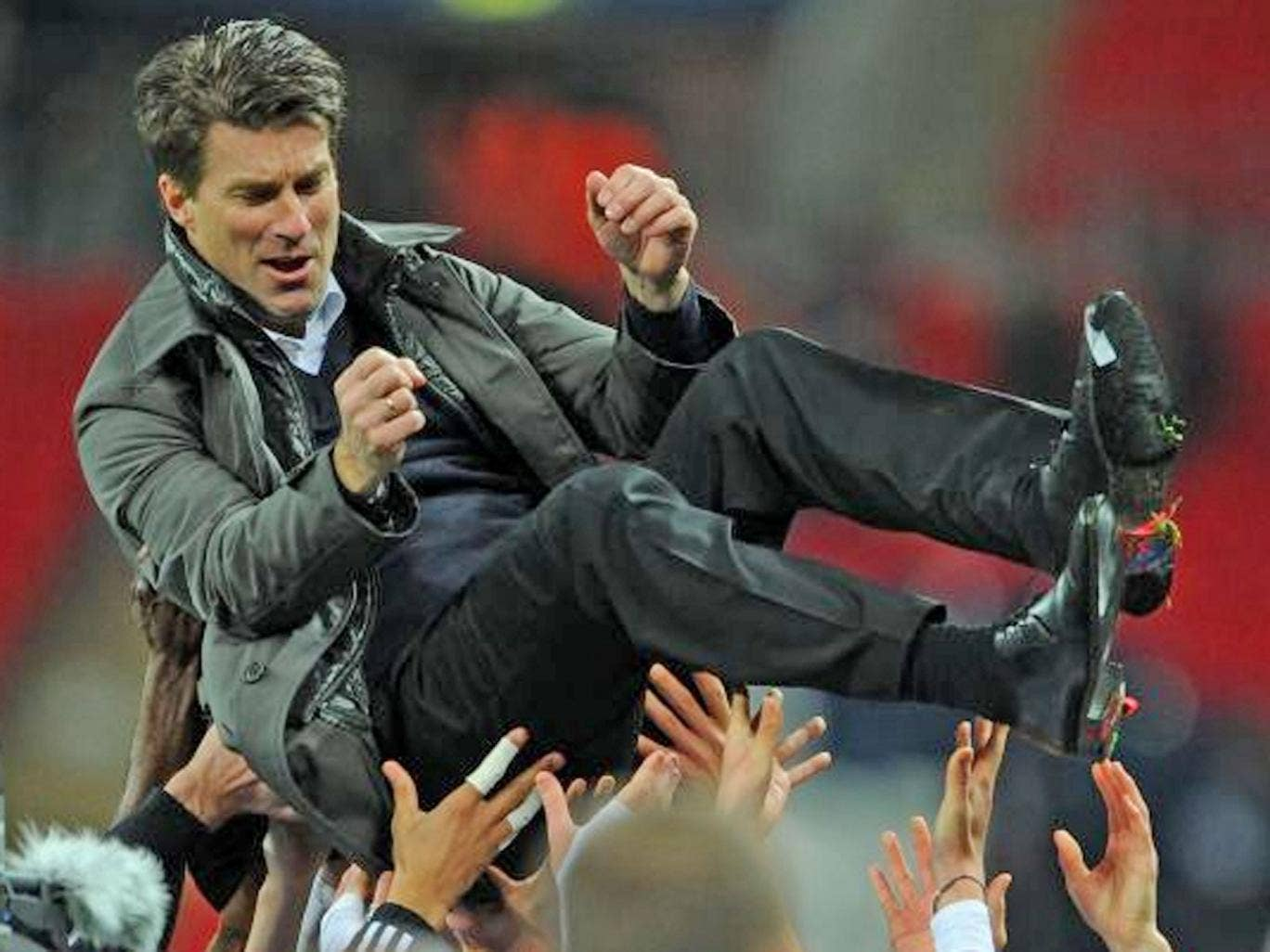 Michael Laudrup celebrates winning the trophy yesterday