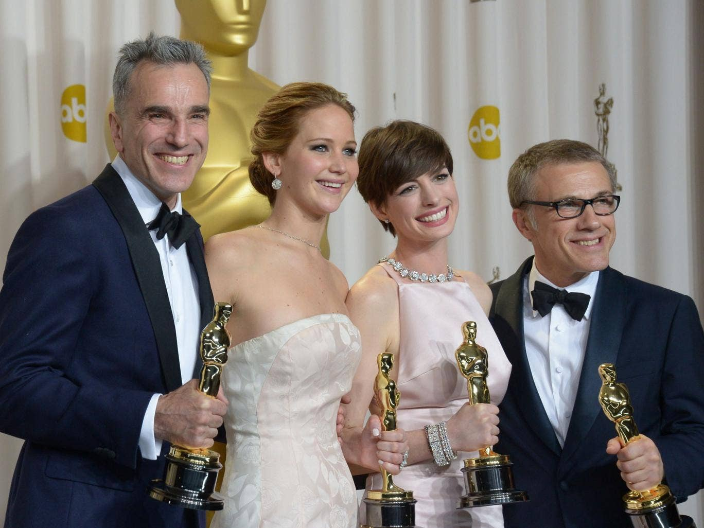 Daniel Day-Lewis, Jennifer Lawrence, Anne Hathaway, and Christoph Waltz at the 2013 Oscars - the four winners will be presenting awards on Sunday