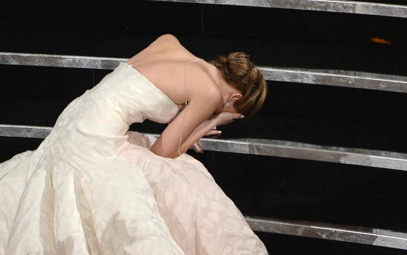 Jennifer Lawrence falls over en route to collect her Best Actress Oscar in 2013