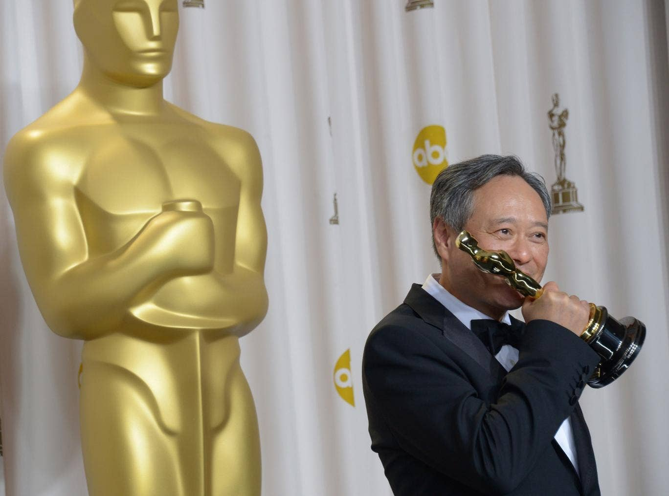 Ang Lee with his award for best director and the Oscars 2013