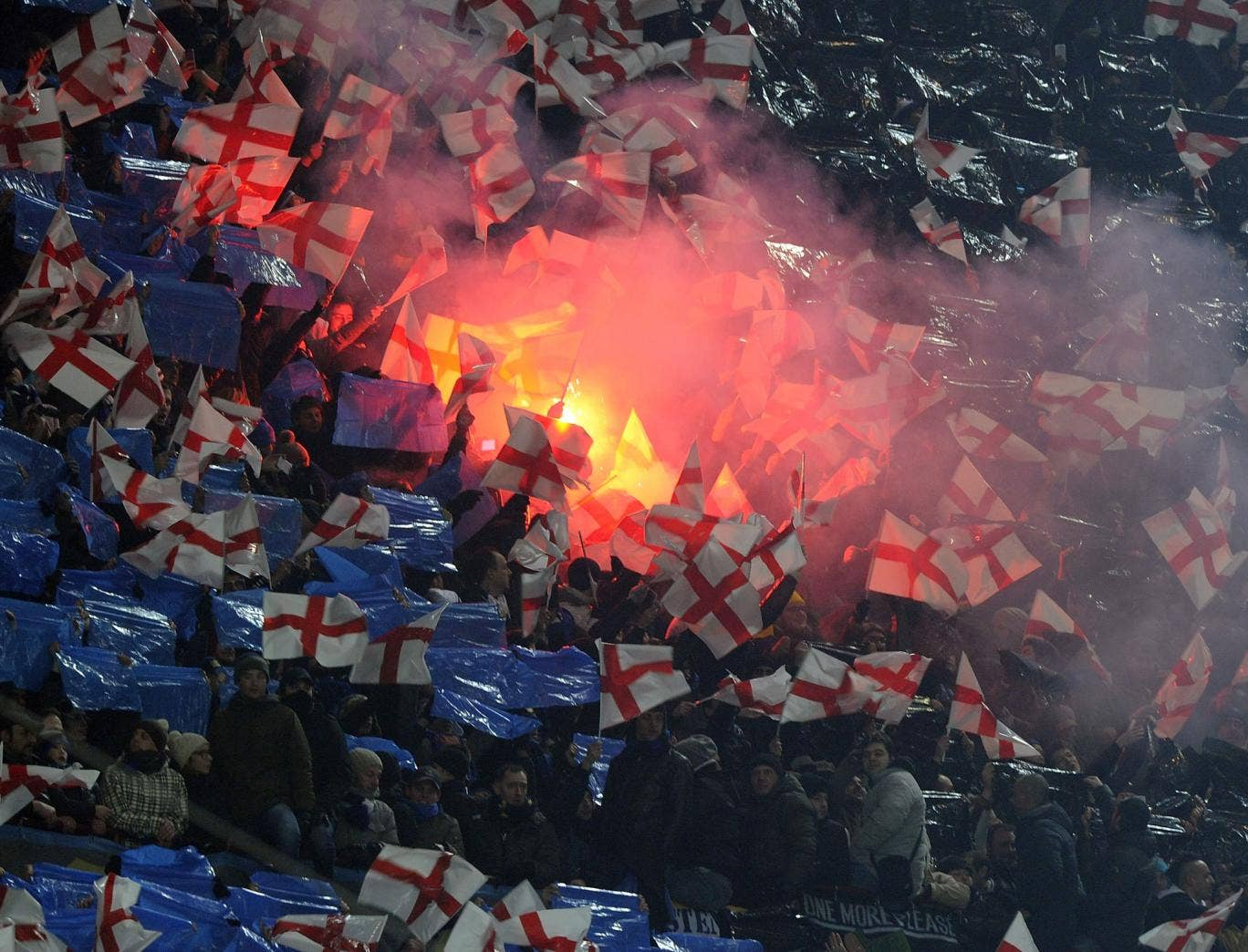 Inter fans wave flags and set off flares at the San Siro