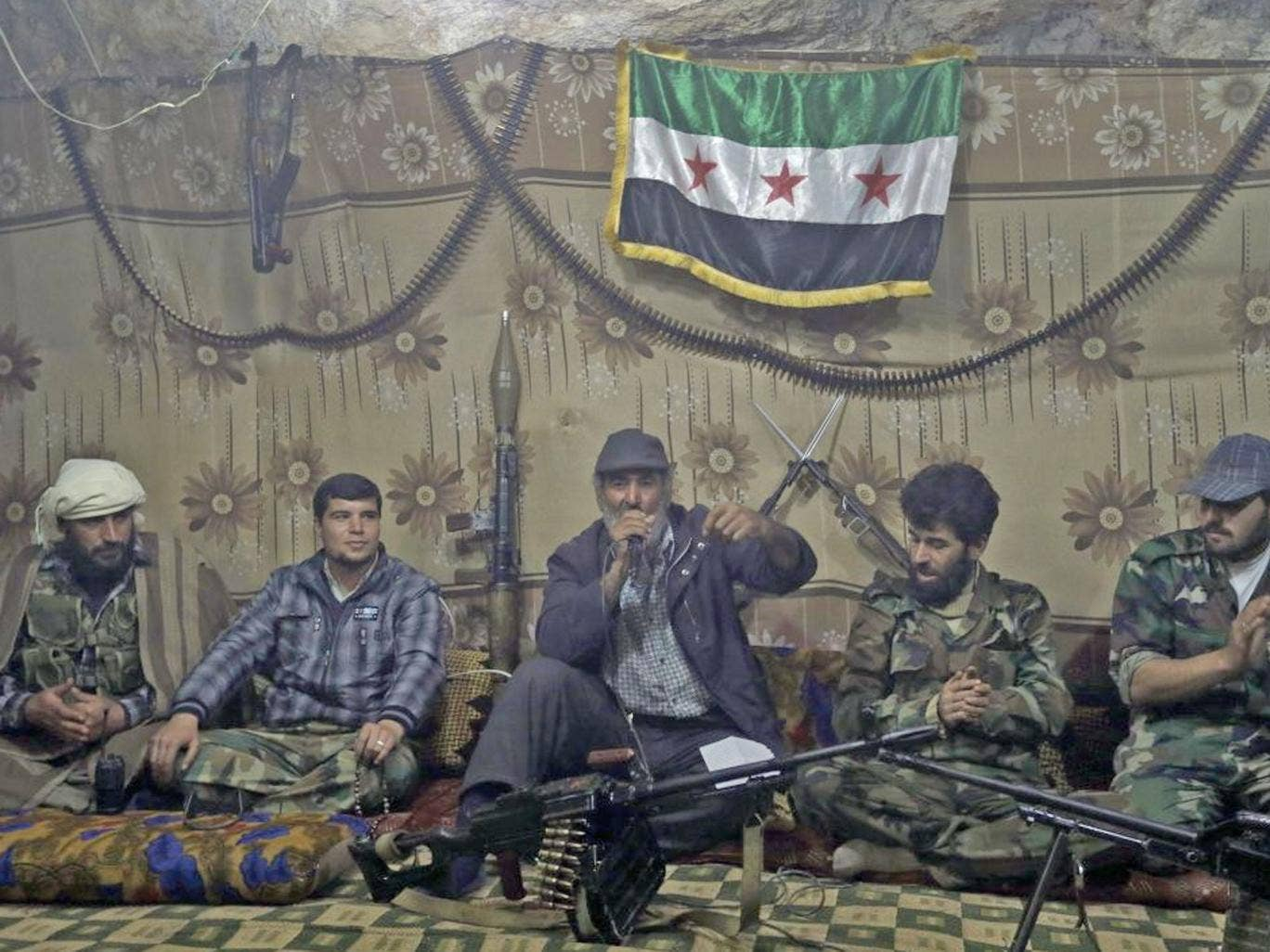 Free Syrian Army fighters gather at one of their caves in Jabal al-Zaweya, Syria, whom reject talks until President Bashar Assad leaves