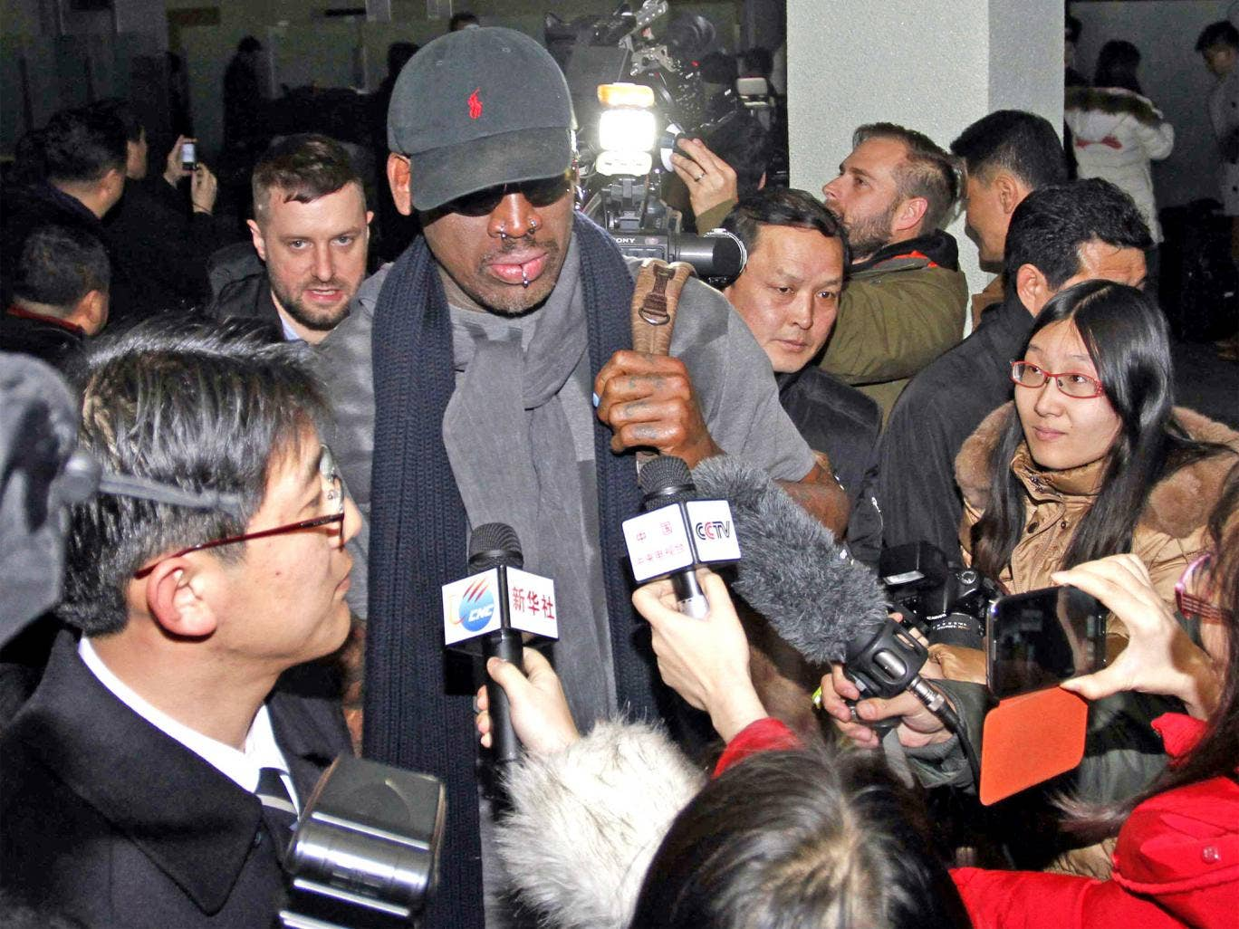 The former NBA star Dennis Rodman arrives in Pyongyang yesterday