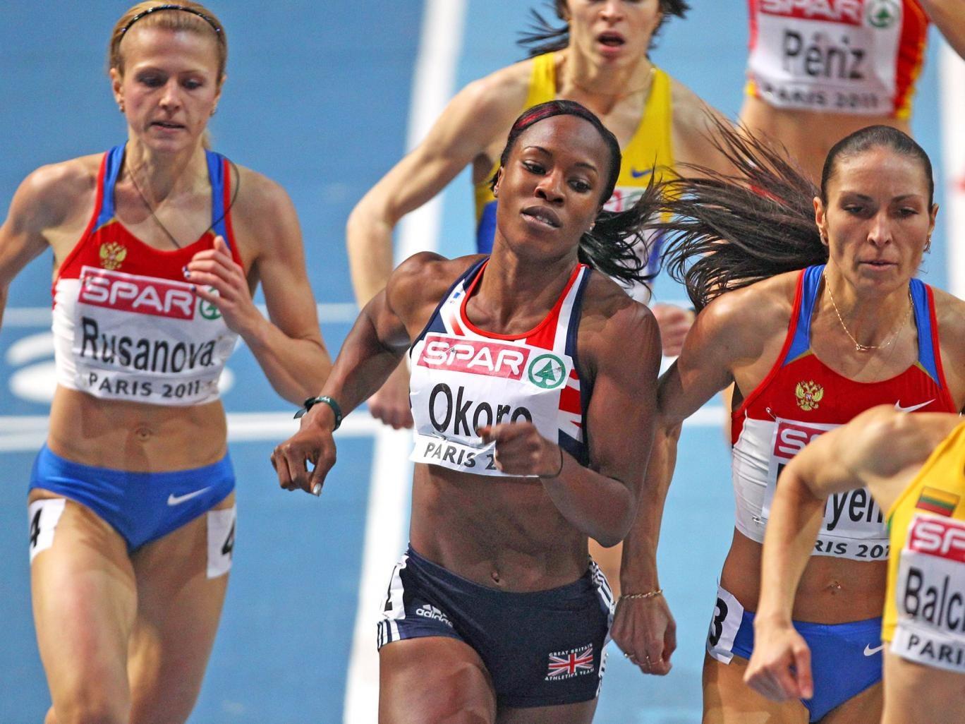 Marilyn Okoro runs during the 2011 Paris Championships. Yuliya Rusanova, left, has been caught doping