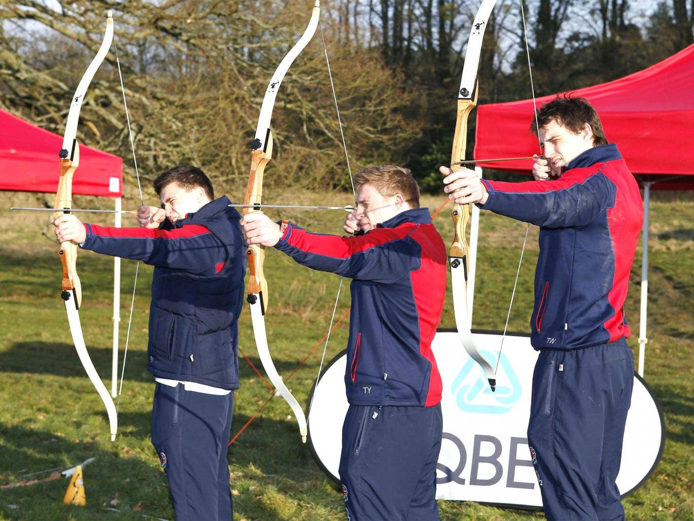 England's Ben Youngs, Tom Youngs and Tom Wood (from left) try their hand at archery at Pennyhill Park yesterday