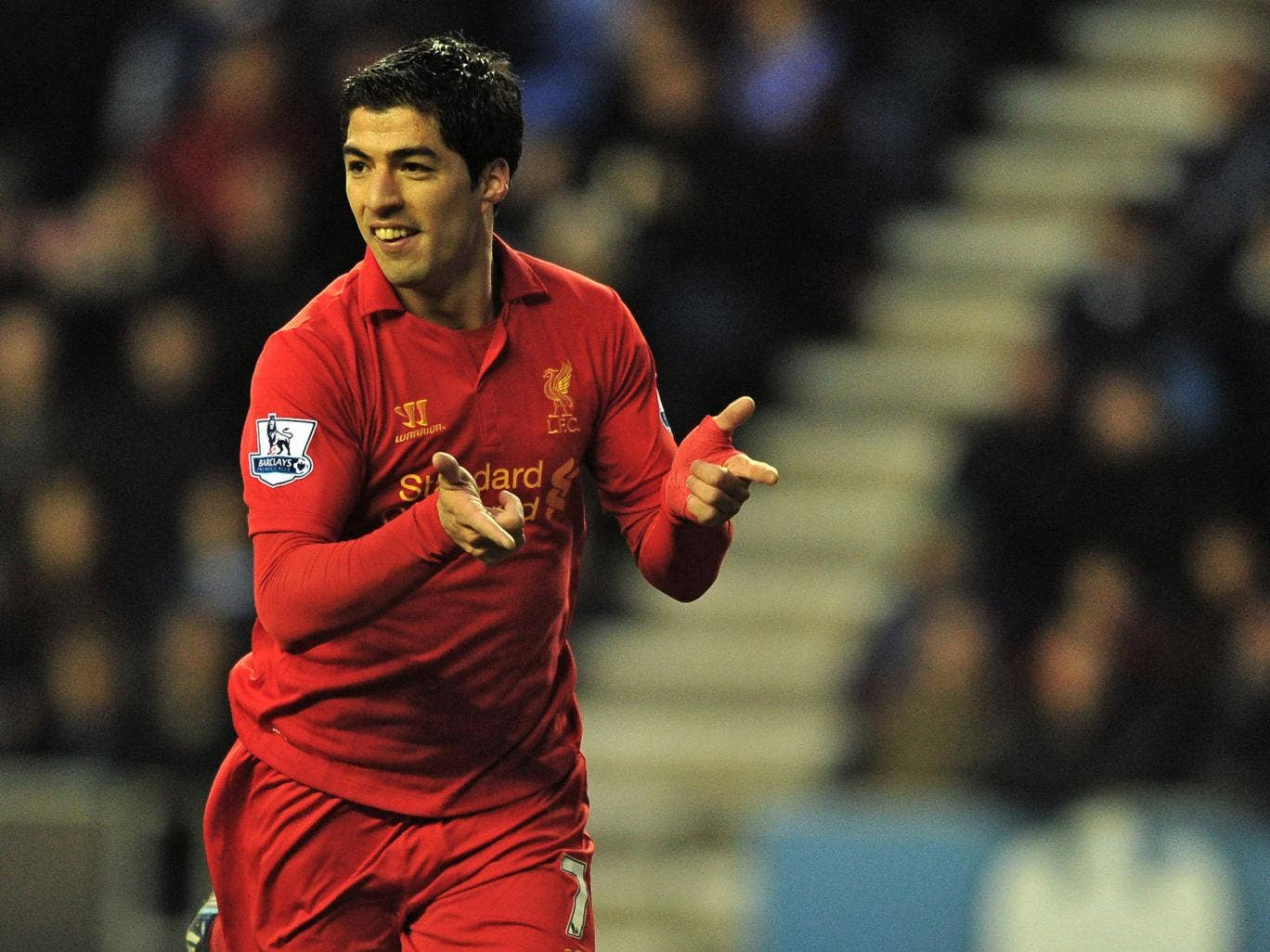Liverpool's Uruguayan striker Luis Suarez celebrates scoring their second goal